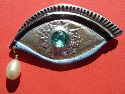 Eye-brooch